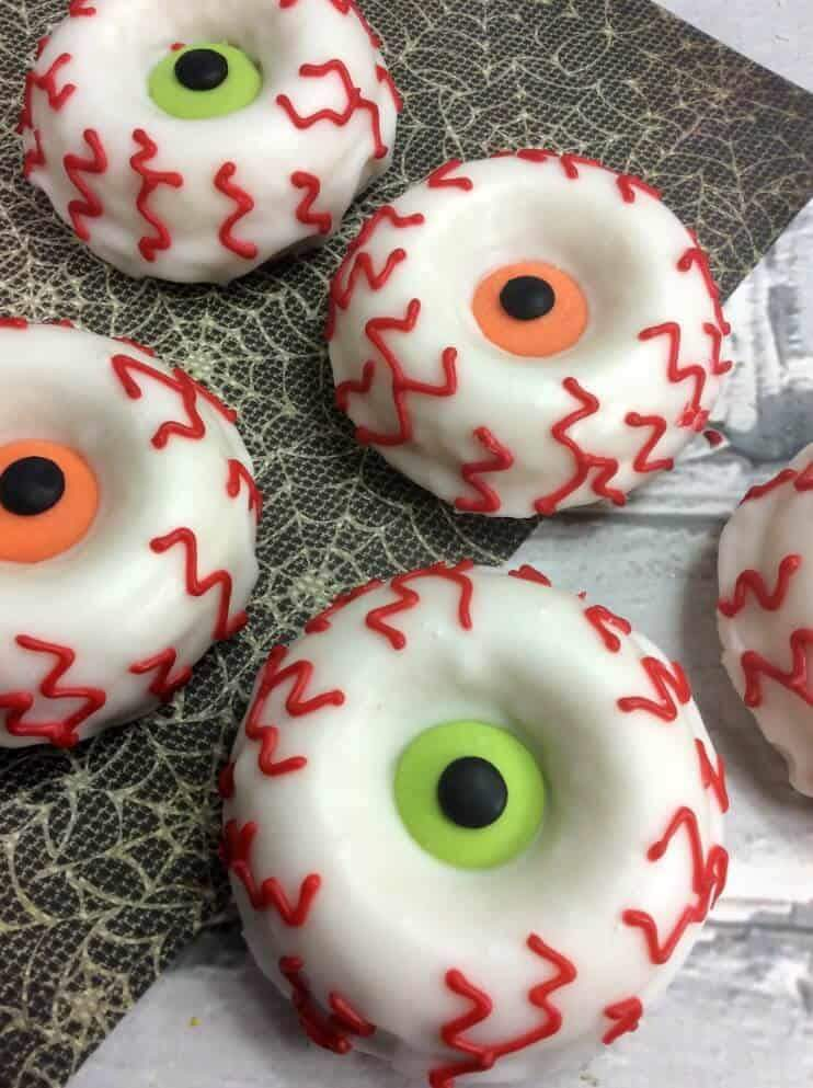 Halloween Monster Eye Donuts on a spider web background