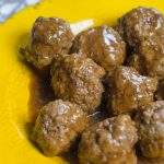 barbecue meatballs in a yellow bowl on a table