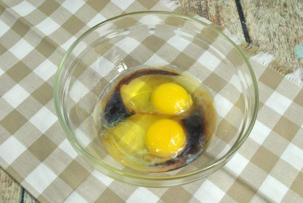 mixing together eggs and extracts