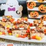 Peanut Butter and Chocolate Monster Crunch Bars on a plate with Halloween ghost decoration.